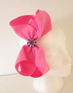 Fancy Gil Boutique Big Hot Pink Cheer Bow Rhinestone Headband. Handmade by FancyGirlBoutiqueNYC, $14.99