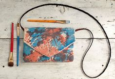 Hand painted canvas purse, tie dye, envelope purse, peach and blue, leather strap on Etsy, $64.00
