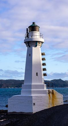 Looking back across the harbour towards Wellington from the Pencarrow Lighthouse. Lighthouse Lighting, Lighthouse Pictures, Beacon Of Light, Tall Ships, New Zealand, Beautiful Places, Castle, Around The Worlds, Building