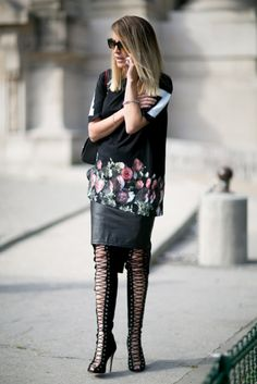 """Très Chic! The Best Street Snaps at PFW: Channeling the Parisian rocker vibe.  : Her gray skirt didn't just break up the all black, it lent a flirtier finish.  : Her shirt told a sporty story, but those boots had """"high fashion"""" written all over them."""