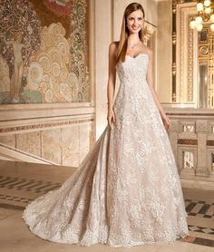 Demetrios Bride 1495,This classic princess silhouette wedding dress is richly embellished with beaded Alencon lace and features a sweetheart neckline and chapel train.Available Colors:Ivory/Nude,Ivory,White.