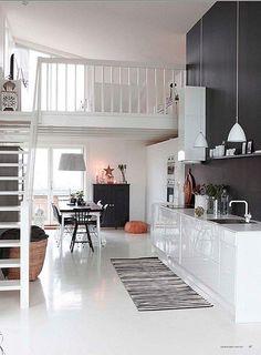 Loft com decoração preta e branca.
