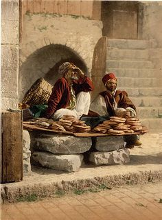 Selling Bread - Jerusalem in 1890. Did color photography exist in Israel in 1890??? (Anne)