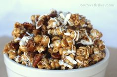 """The most amazing caramel corn in existence. Cinnamon Caramel, toasted pecans, and white chocolate """"icing"""". By far, one of our most popular recipes!"""