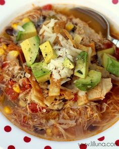 Delicious Chicken Tortilla Soup Recipe. I used a touch less (sea) salt and pepper and added a can of drained black beans. Topped with avocado, cilantro, and tortilla chips. SO GOOD!!!