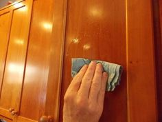There is hope for those cabinets yet. In a small bowl, mix 1 tbsp of baking soda, a 1/2 tbsp of dish soap, and a 1/2 tablespoon of water. Mix it all up in a small bowl to make a paste. Use a clean rag to gently rub the mixture over the cabinets. If you have a high gloss finish, it wouldn't hurt to test a small area before doing the entire thing. Once you have applied the mixture, use a warm washcloth to wipe it off. The fingerprints, grease and flying cookie batter will be gone!