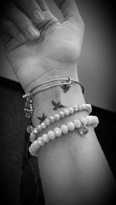 It's all for the birds. Birds wrist tattoo. better photo than the last one. Loving it. Wrist tattoo