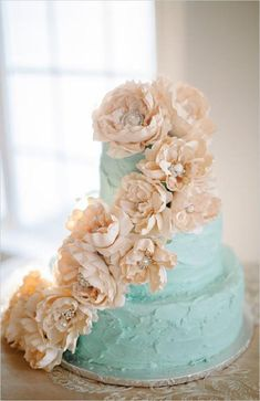 pale blue wedding cake with ivory flowers - so beautiful! ~  we ❤ this! moncheribridals.com