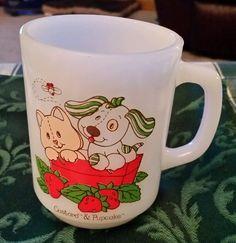 http://www.ebay.com/itm/Vintage-Custard-Pupcake-Strawberry-Shortcake-Coffee-Mug-1981-Anchor-Hocking-/131909254639?hash=item1eb6677def:g:esEAAOSw65FXsf3J