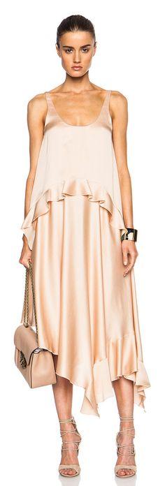 Long dress by Stella McCartney. 100% silk.  Made in Hungary.  Unlined.  Hidden side zip closure.  Fabric overlay detail along top...