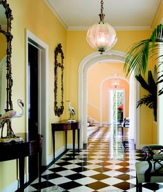 Hassan Estate interior foyer: The Lauders' Palm Beach Mansion: Whimsies abound including these spherical Venetian glass chandeliers from the - Palm Beach, Beach Mansion, Checkered Floors, Interior Decorating, Interior Design, Yellow Walls, Yellow Hallway, Entry Hall, Console Table