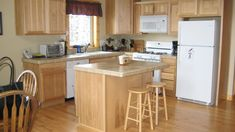 Spacious kitchen for group cooking. Fully equipped with small appliances, seasonings, and basic pantry items.