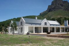 south african farmhouse architecture - small window just above stope to let in light Farmhouse Architecture, Modern Farmhouse Exterior, Architecture Details, Farmhouse Style, Colonial Architecture, Farmhouse Design, South African Homes, African House, Ranch Farm House