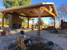 Covered Patio with Stone Fireplace, Bubbling Rock, and Waterfall