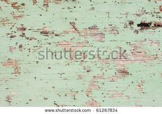 Flaking Green Paint on Faded Wood Background by Rob kemp, via Shutterstock