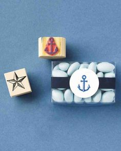 Grab a stamp with a seaside motif and an ink pad to decorate favor tags and more. Here, an anchor-adorned circle attached to ribbon dresses up dragées.Sayabell stamps anchor stamp; 100 proof press nautical star stamp; both from Etsy. Clear box, #007-322.