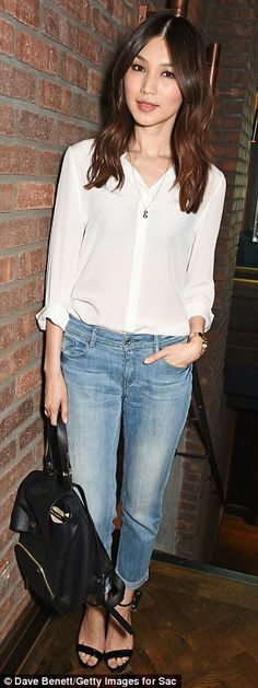 Casual affair: Humans actress Gemma Chan opted for a casual vibe in jeans, a shirt and a r...