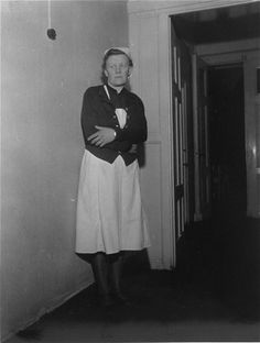 Irmgard Huber, chief nurse at Hadamar Institute, poses in the corridor of the euthanasia facility. The euthanasia killings began in Aug 1939 with the murder of disabled infants and toddlers. In addition to the mentally and physically disabled, thousands of others met their end at Hadamar, including healthy Jewish Mischling children (the children of mixed marriages), tubercular Eastern European forced laborers (Ostarbeiter), German geriatric patients, and disabled German soldiers.