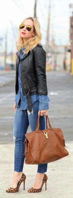 Awesome denim long skirt with denim stylish jeans and brown leather hand bag and top black leather short jacket and leopard high heels pumps