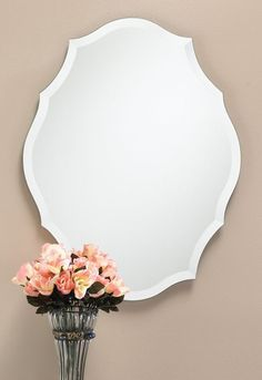 """309 – """"Victorian"""" shaped frameless mirror with 1″ beveled edge.23 1/2″ wide, 30 1/2″ high and 3/8″ deep"""
