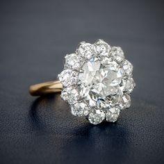 A Stunning and Rare Edwardian Era Inspired Cluster Engagement Ring, featuring an Old European Cut Diamond. anillos de compromiso | alianzas de boda | anillos de compromiso baratos http://amzn.to/297uk4t