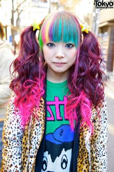 Rainbow colored bangs nad curly brown pigtails with pink tips