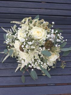 Hand picked style bouquet. With white roses, spray roses, astilbe, astrantia and gypsophila. In whites and greens for a shabby chic rustic look