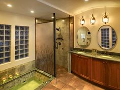 The subtle Universal Design features in this master bath include a dam-free walk-in shower that is beneficial because there are no tripping hazards. Remodel by McClurg.