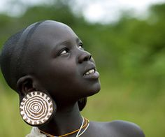 * Surma Suri girl with big earrings - Ethiopia   - Explore the World with Travel Nerd Nici, one Country at a Time. http://TravelNerdNici.com