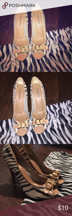 Charlotte Russe zebra heels These are super cute and easy to wear/walk heels . They are used, contains small stains as photographed . These tan black and white heel go great with a little black dress . Size 9 comes with free gift 🛍🎁 Charlotte Russe Shoes Heels
