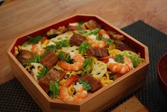 COOKING ROOM 401 : Japanese BENTO that including vinegared rice with thin strips of egg, pieces of raw fish, vegetables and crab meat arranged on top