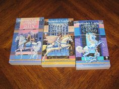 A set of the Heralds of Valdemar trilogy: Arrows of the Queen, Arrow's Flight and Arrow's Fall by Mercedes Lackey.