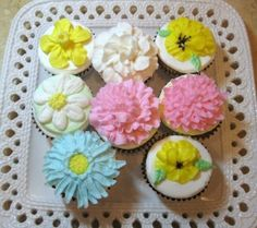 Buttercream Flowers on Cupcakes - In this cupcake video tutorial, you will learn how to pipe buttercream flowers, including buttercream daffodils, pansies, mums, gardenias, carnations, and more !