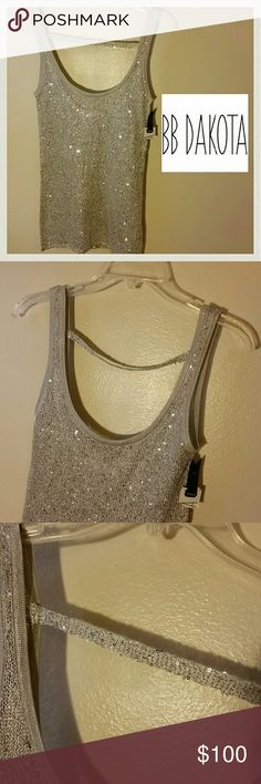 SALE! NWT! BB DAKOTA SILVER SEQUIN TANK NWT. NEVER WORN. Perfect condition. Half the tag I ripped off some time ago. Perfect because it's been hanging in my closet. This tank is incredible. High end. Lightweight. Check out the craftsmanship in the pictures above. The strap that goes horizontal is in the back. The back is a little lower than the front. The strap is not only for design. It's there to keep the tank nice and straight on the body. 100% Poly. Bag of thread and extra sequins sewn…
