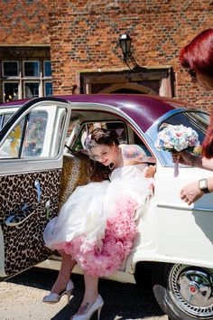 Pink petticoats, tattooed bride AND a vintage car w/ retro leopard interior?! Too much cool - can't take it!