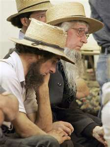 Amish men contemplating & discussing the latest news in the community!