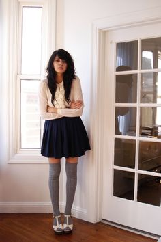 """exactly the kind of winter outfit i had in mind, cuddly white top, cute navy short skirt and grey socks with cute white heels, coupled with that """"i know i am pretty and worth a million bucks so dont bother messing with me"""" expression* LOL :) love it! :D"""