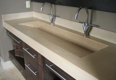solid piece double trough sink & counter. Perfect. Creates more counter space.