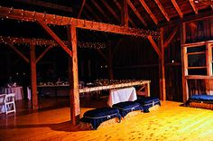 This barn was the space for cocktail hour, and then was utilized again for dancing.  Lights were strung around the beams and hay bales were covered in fabric so guests had a rustically authentic place to sit.  Dinner was served in the tent just steps away.  From the Bachey wedding, 8.6.11 in Vermont.  Photo by Erica Ferrone.
