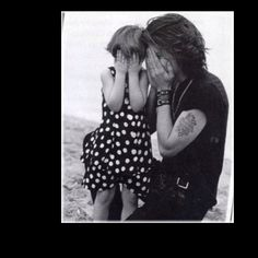 Jon Bon Jovi sweet daddy!OMG!It's not Jon Bon Jovi!It's Johnny Depp!In fact,there was something wrong with the tattoo on the left bicep!Anyway,too sweet!I'm not gonna delete it!