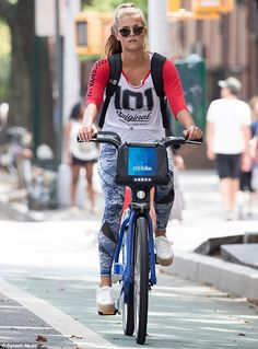 There she goes: Nina Agdal, 24, enjoyed a bike ride in New York City on Sunday