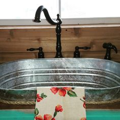 My husband and I did our kitchen sink out of a galvanized wash tub/bucket. At our tiny house we call Hillbilly Hide-a-way at Booger Hollow B&B