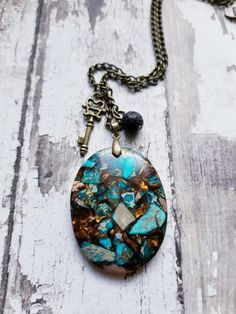 This beautiful necklace is made from genuine, natural copper bornite and sea sediment stone. Its been polished and cut into an oval shape and is approx 2 inches long. The flecks within the stone shine and sparkle in the light, resembling a beaitiful stained glass window. It dangles from a 28 inch