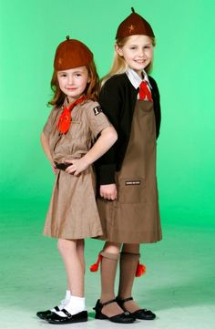 Girl Scout Uniforms - Then and Now. I had the old style brownie uniform, like the one on the left.