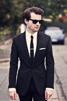 A tailored black suit