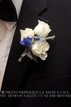 boutonniere with trio of white roses and blue accent