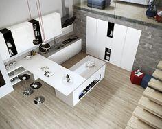 Loft com cozinha ampla e parede em bloco de concreto