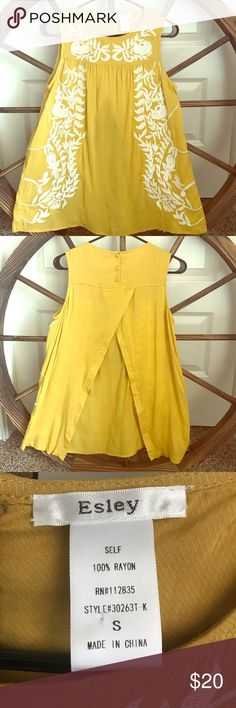 Beautifully embroidered sleeveless blouse Beautiful warm yellow top with white embroidery.  The back has adorable buttons and opens up just beneath.  Perfect for work with a camisole layered underneath. Esley Tops Blouses