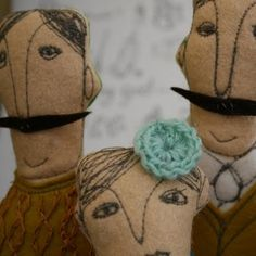felt and machine stitched dolls.....great faces and characters