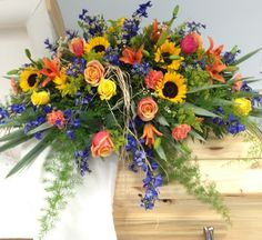Sunflowers Casket Spray from your Sebring, Florida florist